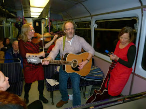 Photo: Mike sings on the final distance to Sheffield with Kiri on fiddle and Judy on Shaker.