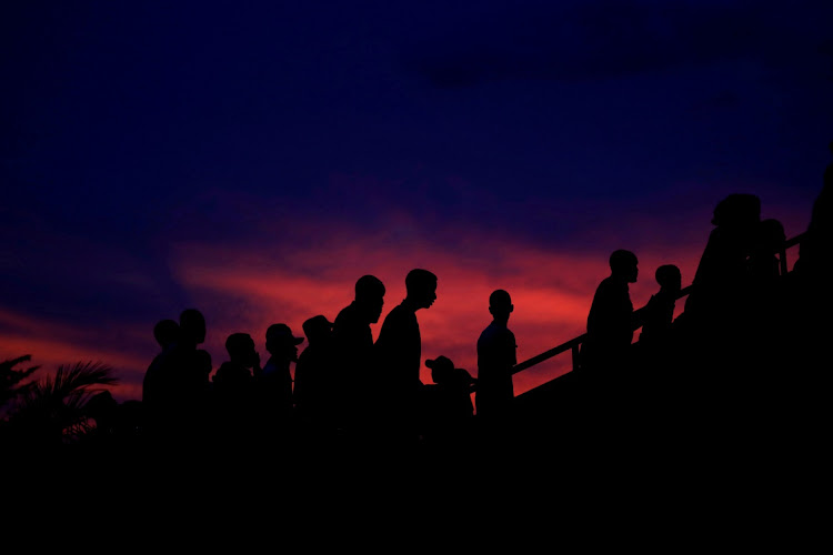 Participants arrive at a night vigil during a commemoration ceremony marking the Rwandan genocide, in Kigali, Rwanda. File photoi: REUTERS/BAZ RATNER