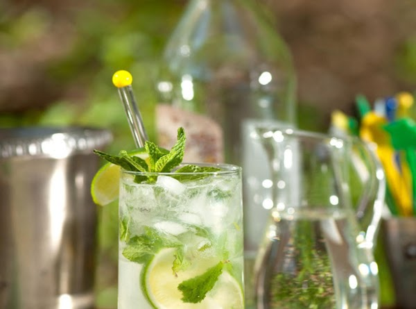 Start with a sprig of mint in the bottom of a glass. Add 1...