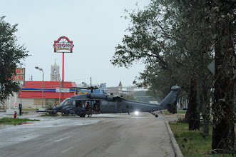 Photo: A U.S. Air Force Search and rescue UH-60 assigned to the 331st Air Expeditionary Group sits in the street during search and rescue operations in Glaveston, Texas after Hurricane Ike, September 13, 2008.  (U.S. Air Force photo by Staff Sgt. James L. Harper Jr.)Released