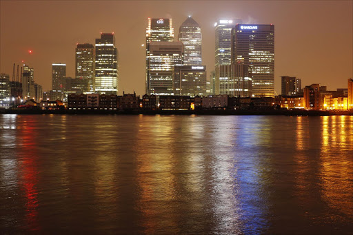 Buildings including Citigroup's offices, left, the HSBC headquarters, centre, and Barclays headquarters, right, in the Canary Wharf financial district in London. Picture: BLOOMBERG/LUKE MACGREGOR