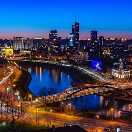 Vilnius Long Exposure by Justin Hyder - City,  Street & Park  Vistas ( capital, vilnius, tall buildings, city, panoramic, tourism, lithuania, aerial, building, colors, summer, scene, beautiful, view, modern, street, cityscape, europe, architecture, sky, new, eastern, famous, town, baltic, center, night, estate, skyscraper, panorama, urban, light, district, sunset, evening, travel )