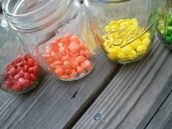 Start by separating each color of Skittle into it's own jar.