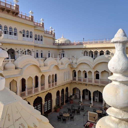 A bird's-eye view of a courtyard at the Alsisar Mahal Hotel in Rajasthan, India.