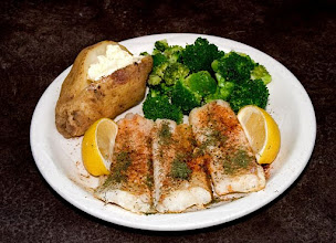 Photo: Baked Cod dinner with lomon broccoli and baked potato