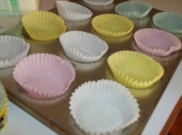 Preheat oven to 375 degree F.  Line a 12 cup muffin tin with paper liners.  Mix...