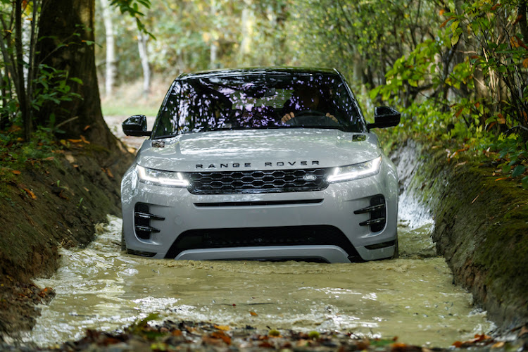 The new Evoque tackles a muddy water obstacle