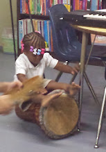 Photo: looks like she is enjoying that drum!