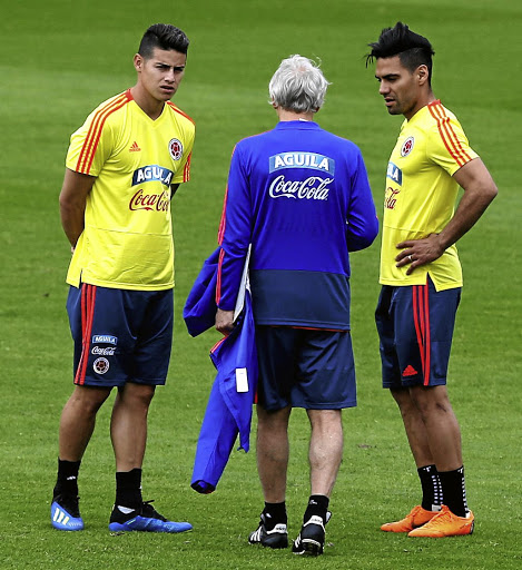 "World Cup attitude: Colombia coach Jose Pekerman, centre, talks tactics with, left, James (pronounced ""Hamez"") Rodriguez, and Radamel Falcao. Picture: REUTERS"