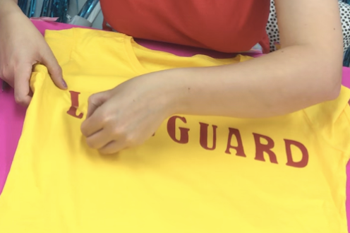 peeling off carrier of happyflex red heat transfer iron on t-shirt to make diy lifeguard t-shirt