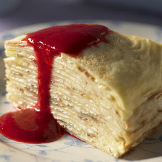 Lemon Crêpe Cake with Raspberry Sauce