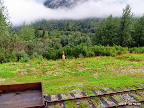 Photo: A maintenance area along the tracks and a maintenance man.