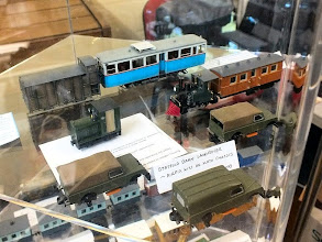 "Photo: 022 Display photo 6. Garry Whiting's 3 ""Statfold Barn type Landrovers"" – Airfix kits on Kato shorty bogie chassis, along with his charming little steam railmotor are featured here. The little Gmeinder diesel mod is bySimon Hargraves and the blue and white railcar at the back is Dean Whiston's FC de Mallorca 00n3 railcar which was winner of the railcar section of the modelling competition ."