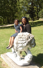 Photo: Kelli and Kaleya by the lion
