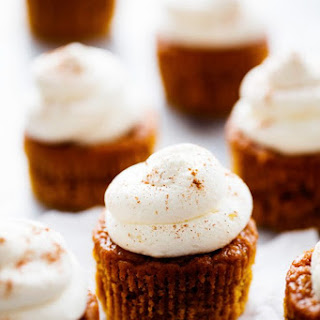 Pumpkin Pie Cupcakes with Cream Cheese Whipping Cream.