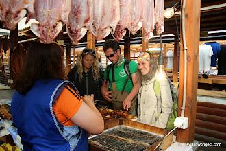 Photo: Georgy bargains for smoked fish at the Baikal market