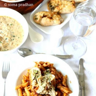 Roasted Chicken Stuffed With Cheese, Mushroom, Broccoli & Spinach Served In White Creamy Sauce And Vegetable Pasta.