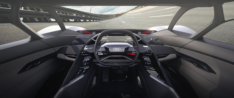 The driver's seat and steering wheel of the Audi PB18 E-tron can be moved to either side of the car or even in the middle. Picture: NEWPRESS UK