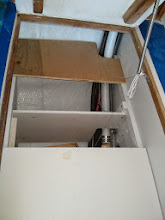 Photo: also gained storage on lower level (outboard of hot water heater) by adding a divider