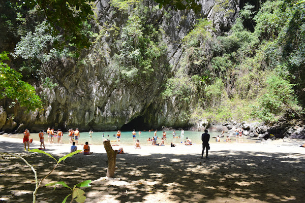 Relax at the small beach of Emerald Lagoon surrounded by steep cliffs