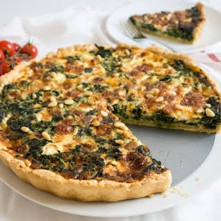Spinach Quiche with Cheese and Pine Nuts.