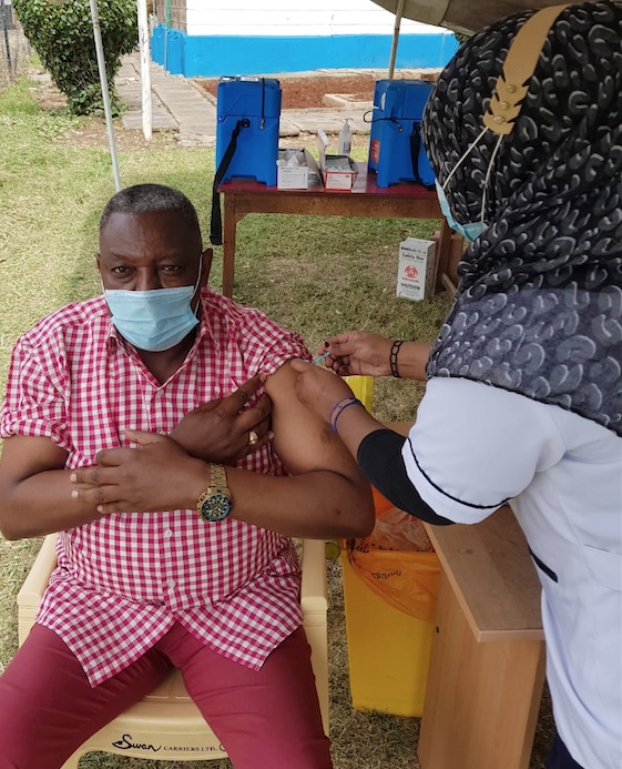 Politician Francis Mwangi getting his vaccination at Mbagathi Hospital on April 1.