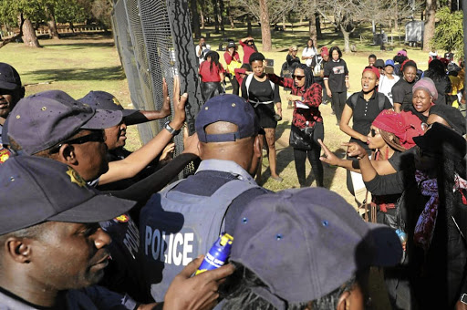 Tension broke out at the Union Buildings as women marchers tried to push their way through police at the gates.