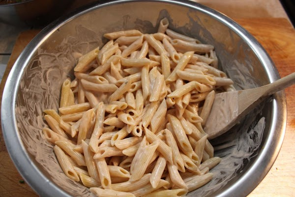 Transfer pasta to the bowl with the sauce. Toss pasta with sauce until all...