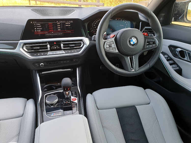 The cabin has carbon fibre décor and comfortable leather-clad sports seats. Picture: DENIS DROPPA