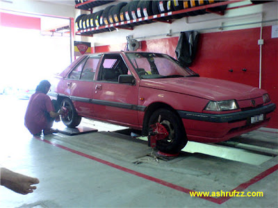 My car undergoing wheel alignment
