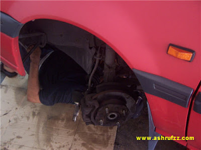 Ashrufzz Car being repaired by a mechanic
