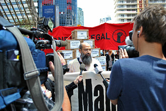 Photo: Mohammad Mahjoub speaks to the media during a rally on June 26, 2012, the 12 year anniversary of his initial arrest.