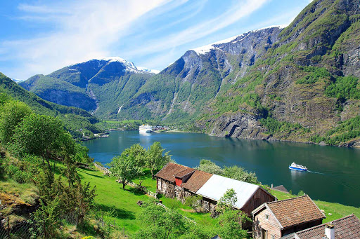 Norway-Aurlandsfjord-traditional-house - Traditional homes line the shores of Aurlandsfjord in Norway.
