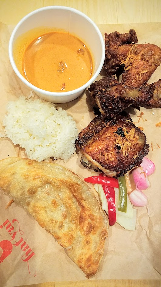 The Hat Yai Combo includes using Marys free range chicken a leg, thigh, and a wing, served with sticky rice, roti, and a rich Malayu style curry broth.