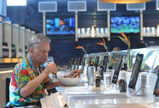 """Photo: William Harden, of Boca Raton, Florida, enjoys a beer and a ramen noodle dish made with wild mushrooms, eggplant and  fish stock at Shoyu Restaurant located on Concourse G at the Minneapolis St. Paul airport on September 5, 2012. """"It's very good, and I grew up in the restaurant business,"""" said Harden. Harden, who was raised in Mankato and worked for The Dayton Hudson Corporation as Vice President of Law, was in the airport on his way back to Florida.   (Pioneer Press: Ginger Pinson)"""