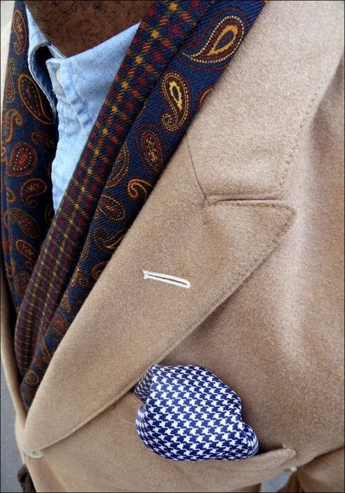 outfit tip for men with a beige jacket and blue paisley pattern scarf