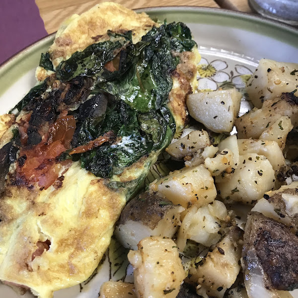 Delicious omelette with homemade herb cheese.