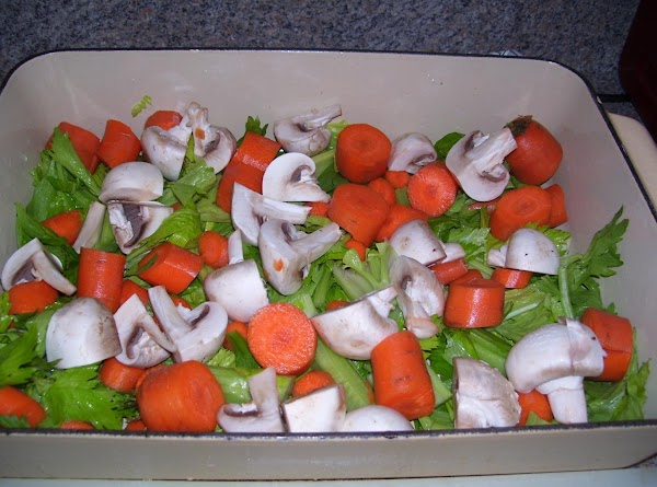 In a large roasting pan, form a bed of whole or roughly chopped vegetables...