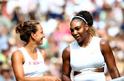 Serena Williams of the US and Czech Republic's Barbora Strycova embrace each other after their Wimbledon semi-final match on Centre Court in London, England, on July 11 2019.