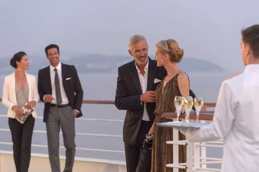 Ponant-LeLyrial-deck-sunset.jpg - Watch the sun go down over a glass of Champagne on the deck of Le Lyrial, a Ponant yacht.