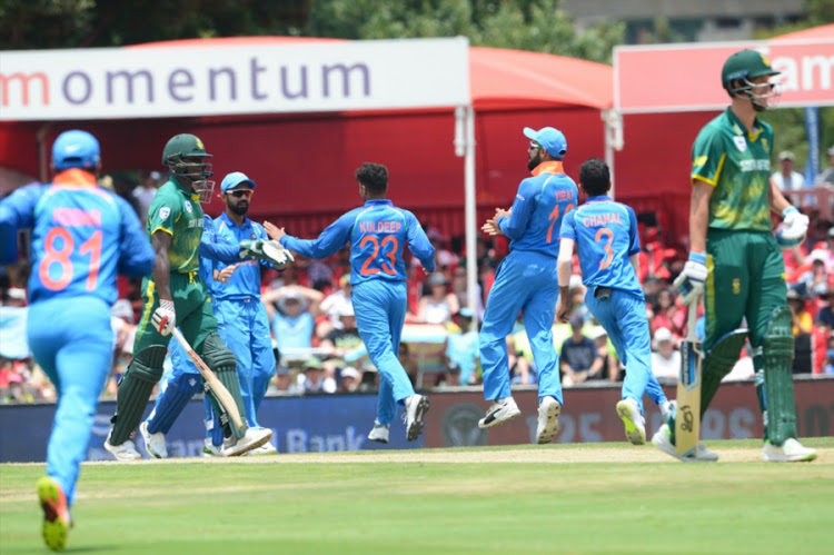 India celebrate the wicket of Kagiso Rabada of the Proteas during the 2nd Momentum ODI match between South Africa and India at SuperSport Park on February 04, 2018 in Pretoria, South Africa.