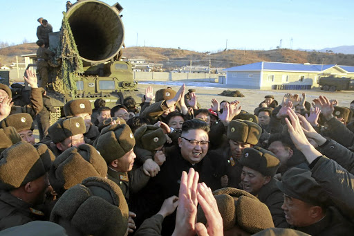 Defiant exercise:  North Korean leader Kim Jong-un is surrounded by cheering soldiers and officials after he guided the launch of Pukguksong-2, in this undated photo released by North Korea's Korean Central News Agency in Pyongyang on Monday.   Picture: REUTERS