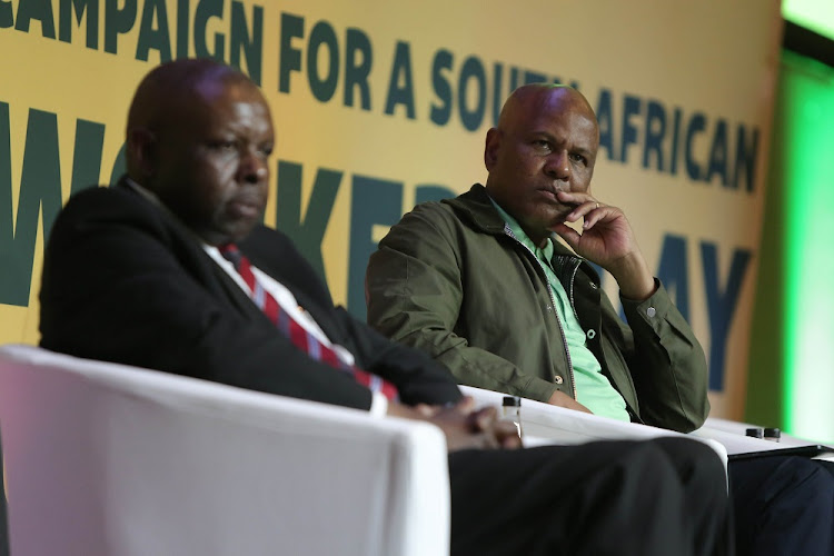 Never forget: Judge president of the High Court in Cape Town John Hlophe, left, and Association of Mineworkers and Construction Union president Joseph Mathunjwa, at the Sandton Convention Centre, Johannesburg, for the Marikana memorial lecture on Wednesday. Picture: ALAISTER RUSSELL