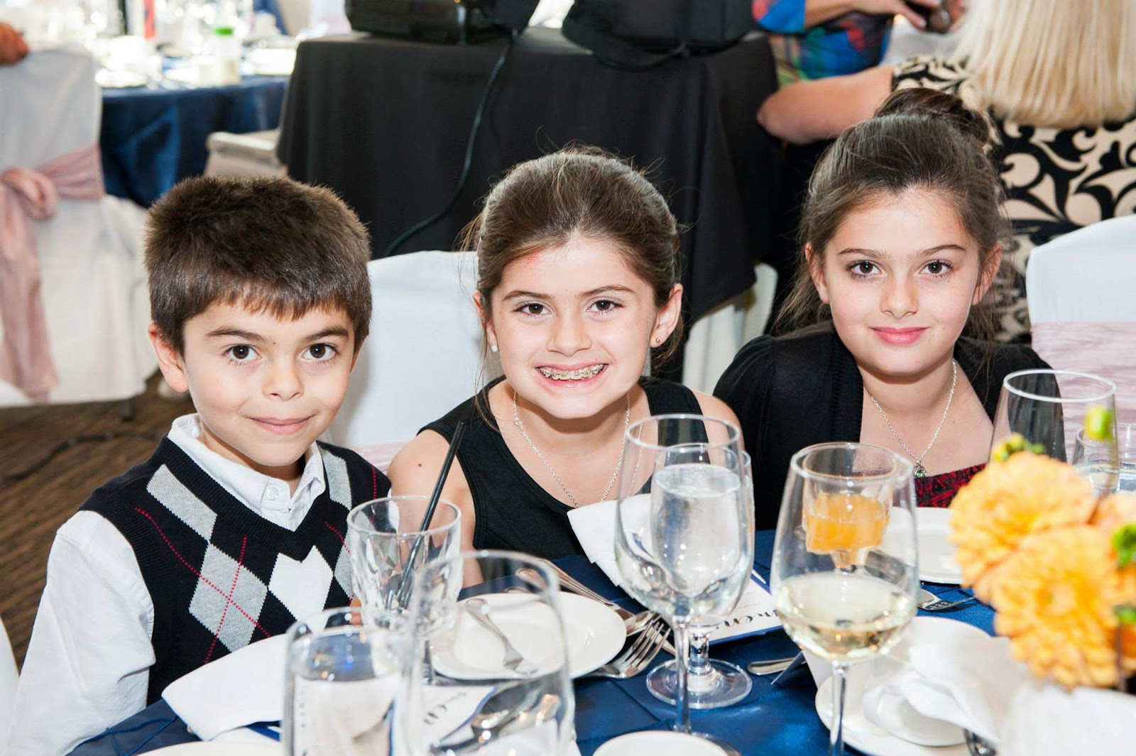 Dersim, 7, Rojevahn, 9, and Sharvahn, 11, at a wedding.