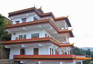 Photo: A side view shows the newly completed, traditional Tibetan architectural building-- the Sowa Rigpa Medical Institute. (Viewed from the Guest House of Menri Monastery).