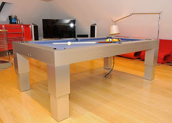 the apex pneumatic pool table risen to be pool table height in a games room