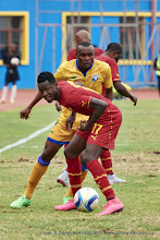 Photo: Baba Rahman (17) shields the ball from Jacques TUYISENGE (9) [Rwanda Vs Ghana AFCON2017 Qualifier, 5 Sep 2015 in Kigali, Rwanda.  Photo © Darren McKinstry 2015