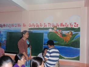 Photo: Mamburaon koulun seinälle maalattu Minun taivaani kirjasta kuvia