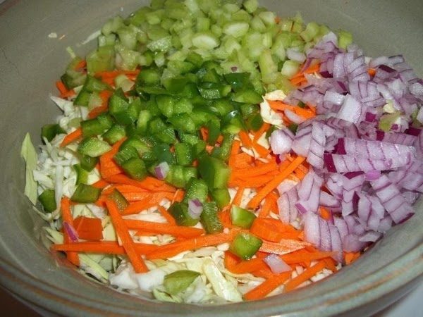 In a large bowl, add all veggies and toss.