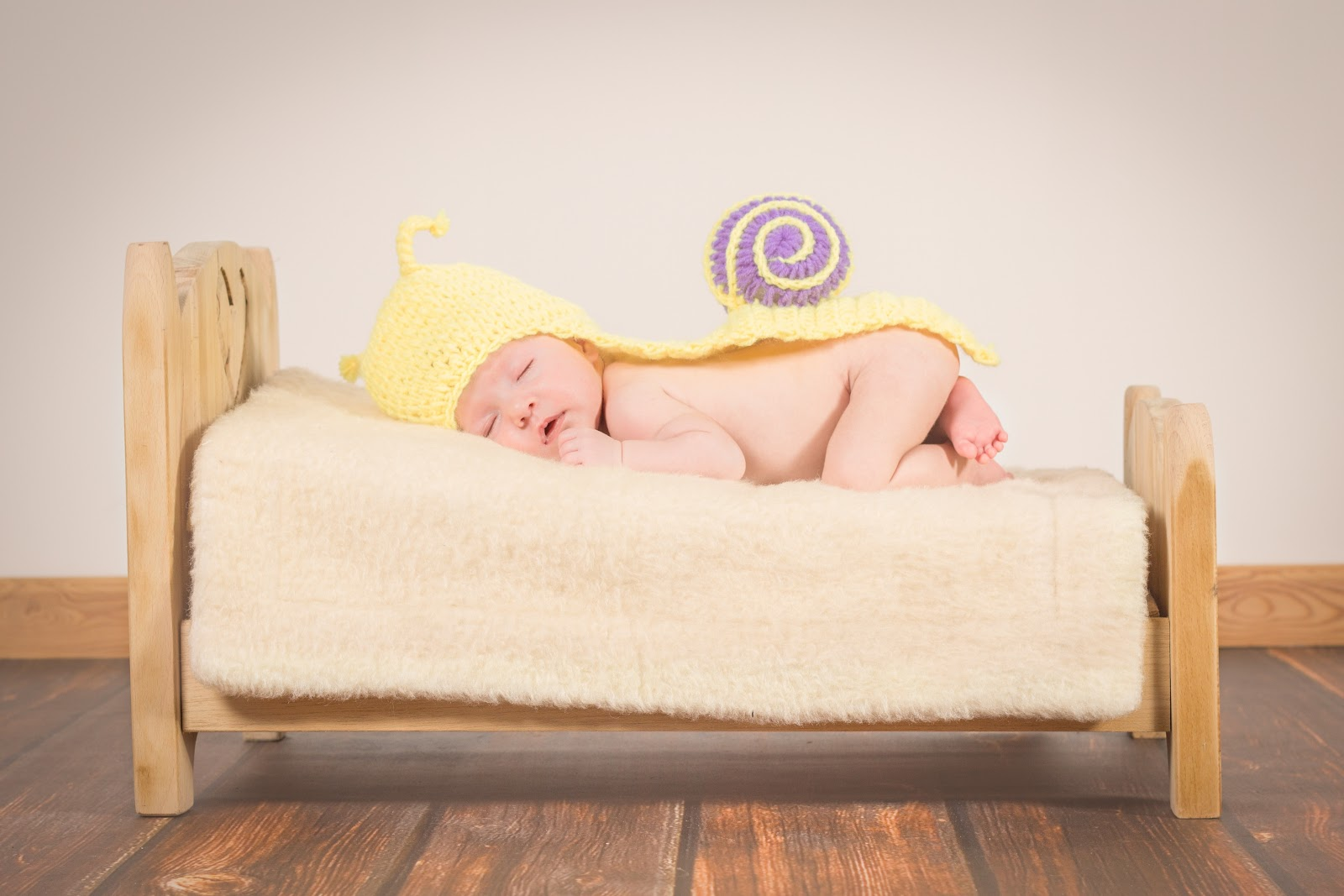 Newborn baby sleeping but it'll soon be time to think of safety in your home